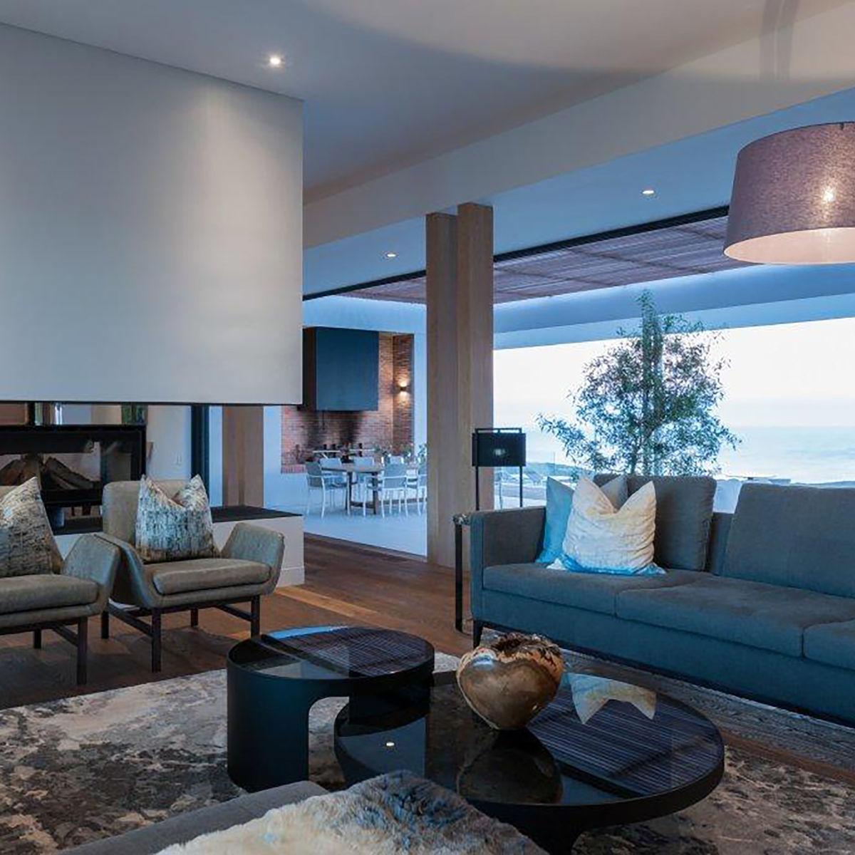 OKHA furniture shown here: Hunt Sofa, Nicci Armchairs, Burbuja Coffee table, and accessories